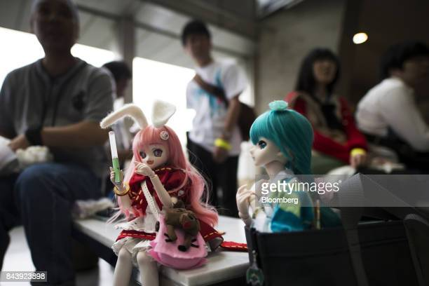 Figures of Hatsune Miku a virtual pop star and the voice behind Crypton Future Media Inc's vocal synthesizer software are seen during the Hatsune...