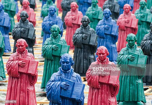 800 figures of Martin Luther of an installation by German artist Ottmar Hoerl are lined up at the market square in the eastern German city of...