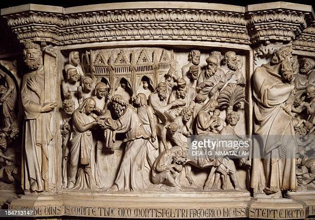 Figures of Prophets framing the Massacre of the innocents scene from the Life of Christ panel on the pulpit in the Cathedral of Pisa 13021310 by...