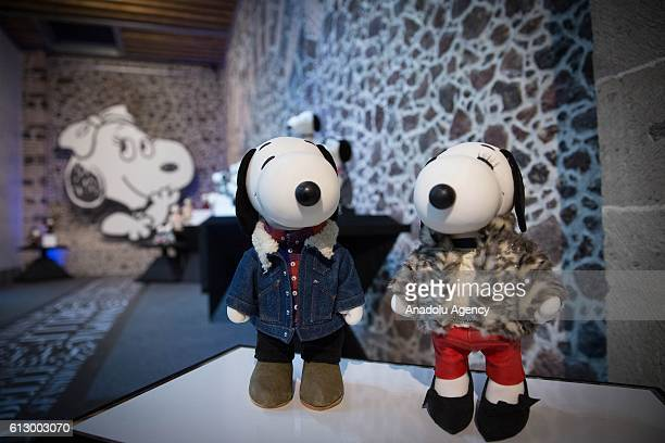 Figures of Snoopy and Belle dressed by Isabel Marant are displayed during the 'Snoopy and Belle in fashion' exhibition as part of 10th year...