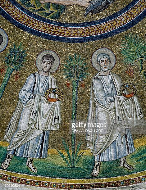 Figures of the Apostles with the crown of martyrdom detail of the early 6th century mosaics of the dome Arian Baptistery Ravenna EmiliaRomagna Italy