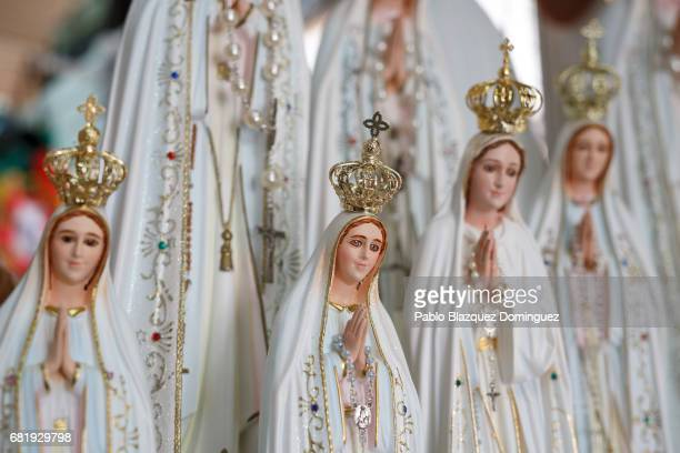 Figures of the Virgin Mary are on display at a souvenirs shop next to the Sanctuary of Fatima on May 11 2017 in Fatima Portugal Pope Francis will be...