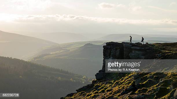 figures stood on bamford edge, derbyshire on a beautiful spring evening - peak district national park stock pictures, royalty-free photos & images