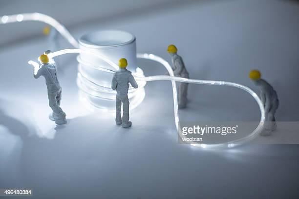 Figurine builders installing electrics