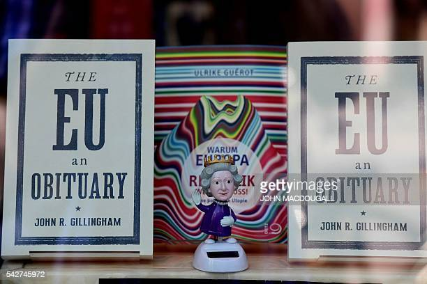 A figurine depicting Britain's queen Elizabeth II is on display near issues of the book 'The EU an Obituary' by John R Gillingham at a book shop...