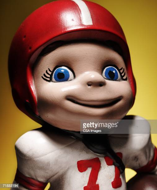 figurine of a football player - bobble head doll stock photos and pictures