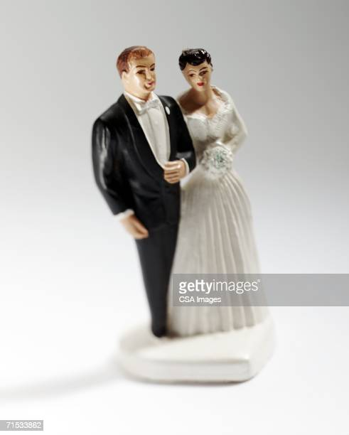 figurine of a wedding couple cake topper - male likeness stock pictures, royalty-free photos & images