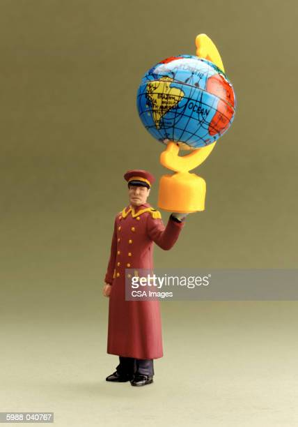 figurine of doorman with globe - doorman stock photos and pictures