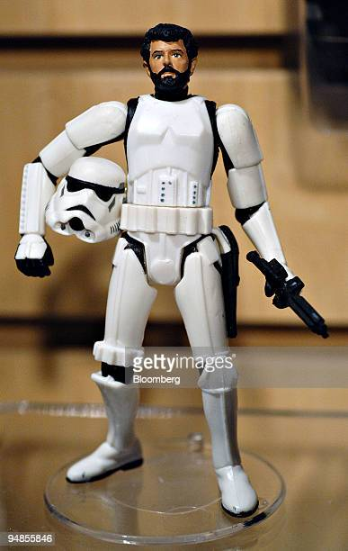 A figurine of George Lucas chairman and founder of Lucasfild LTD and director of the Star Wars films dressed as a Storm Trooper sits on display in...