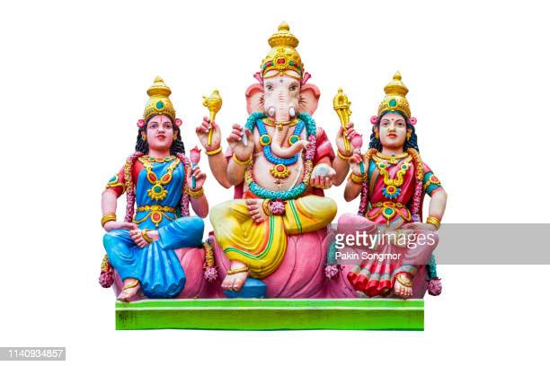 figurine of lord ganesha on white background - dieu hindou photos et images de collection