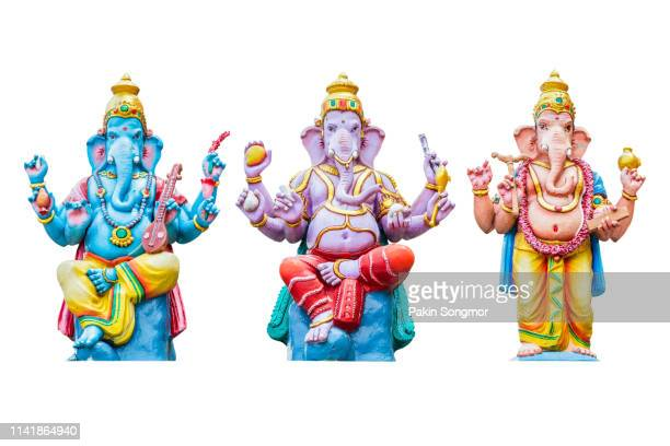 figurine of lord ganesha on white background - ganesha stock pictures, royalty-free photos & images
