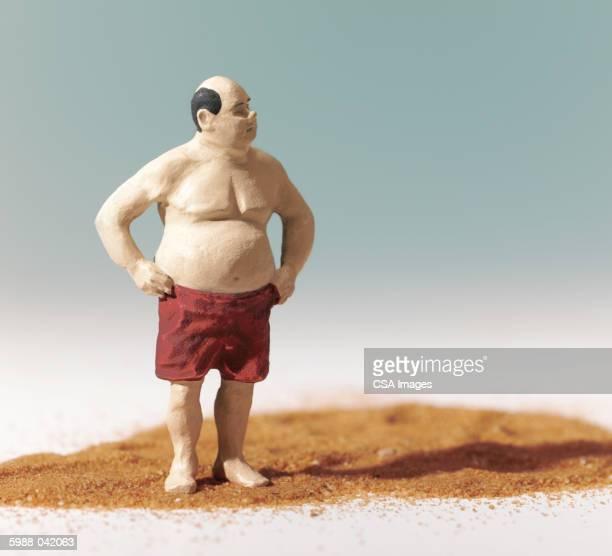 Figurine of Man on Beach