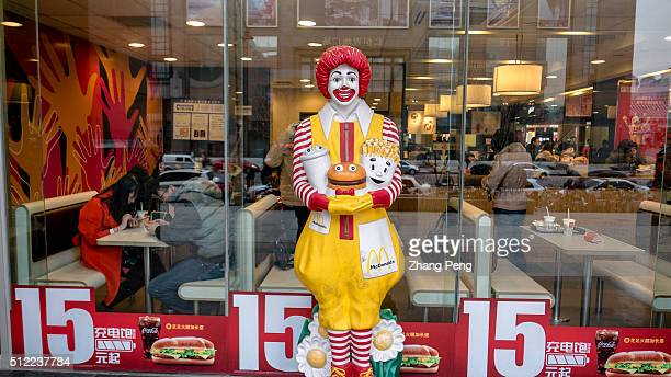 A figurine of Ronald McDonald stands outside a McDonald's restaurant McDonalds announced its fourthquarter samestore sales of 2015 in China rose 4% a...