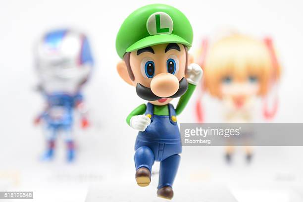 A figurine of the character Luigi from Nitendo's video games and related media stands on display at the Anime Japan 2016 convention in Tokyo Japan on...