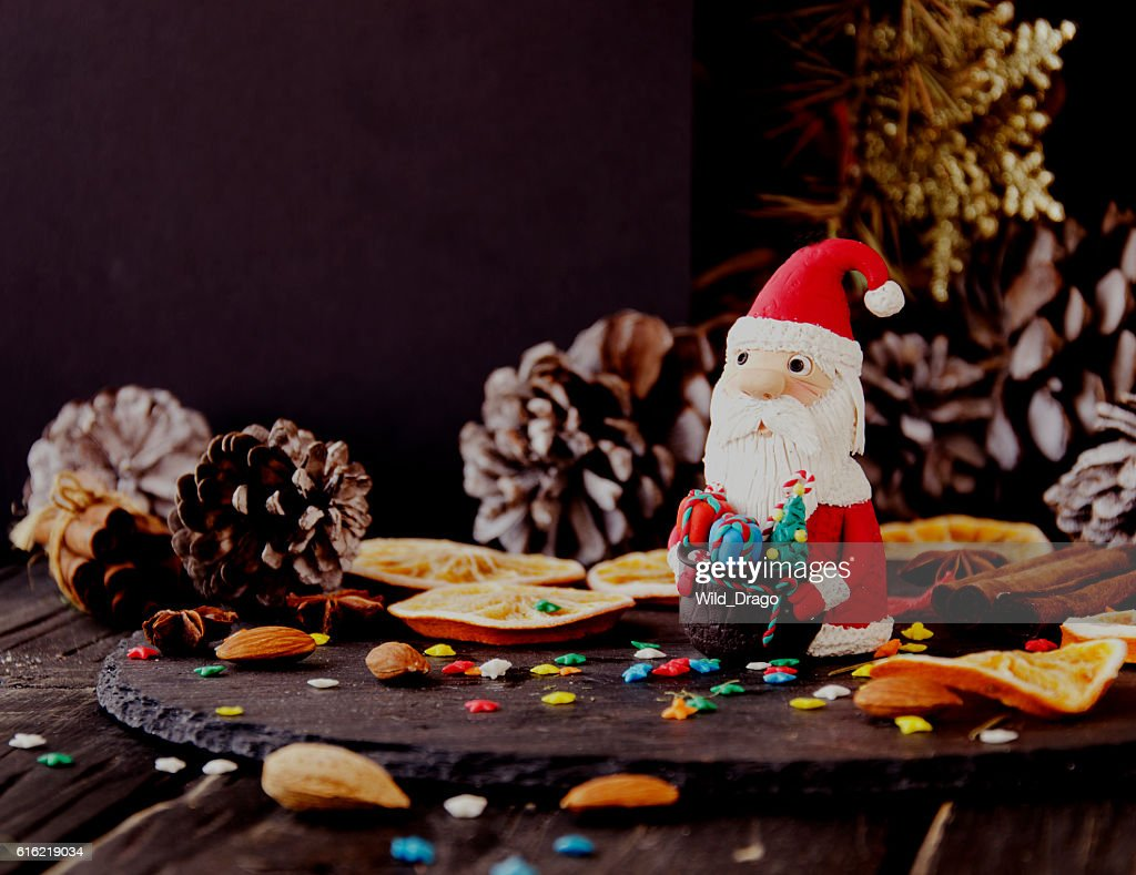 figurine Santa Claus Christmas THE BACKGROUND branches, selective focus : Stock Photo