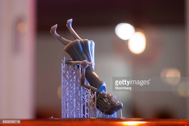 A figurine sits on a desktop after printing inside the offices of 3D printing and design company Formlabs GmbH in Berlin Germany on Tuesday Nov 8...
