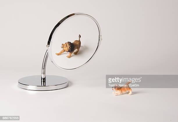 Figurines And Magnifying Glass On Table