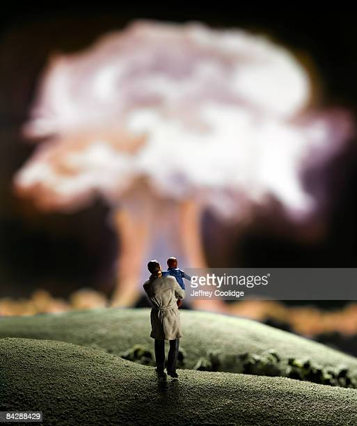 figurines and nuclear explosion - nuclear fallout stock pictures, royalty-free photos & images