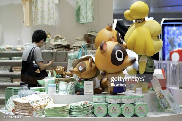 Figurines and plush toys of characters from the Nintendo Co. Video game Animal Crossing: New Horizons are displayed inside the Nintendo TOKYO store...