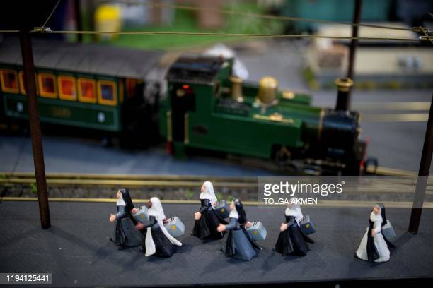 Figurines are pictured with a miniature steam train during a photocall at the London Model Engineering Exhibition at Alexandra Palace in north London...