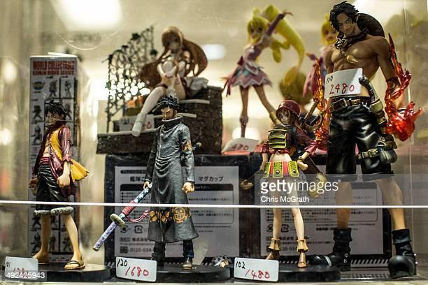 Figurines are seen in a window in Akihabara Electric Town on May 20 2014 in Tokyo Japan Akihabara gained the nickname Akihabara Electric Town after...