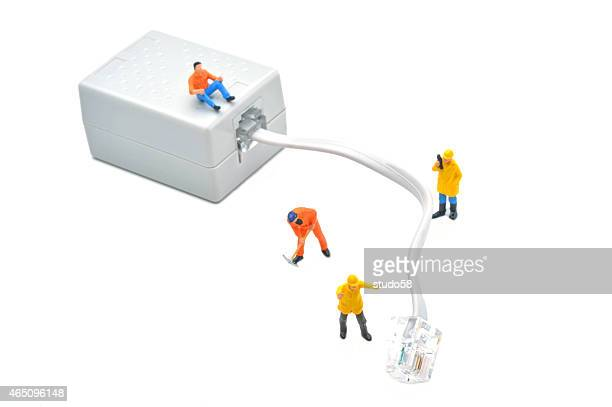 figurines connecting network cable