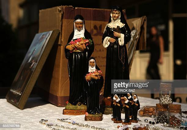 Figurines depicting Saint Rita sit for sale in the Lebanese town of Jdeideh northeast of Beirut on May 21 2016 Saint Rita of Cascia was an Italian...