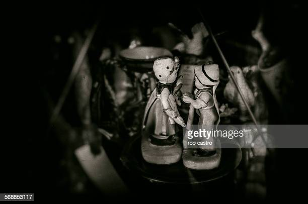 figurines of girl and boy - rob castro stock pictures, royalty-free photos & images