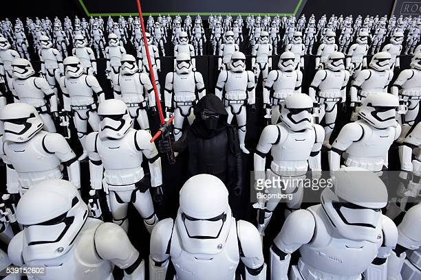 """Figurines of Kylo Ren, center, and First Order Stormtroopers, characters from """"Star Wars"""", are displayed at the Tomy Co. Booth at the International..."""