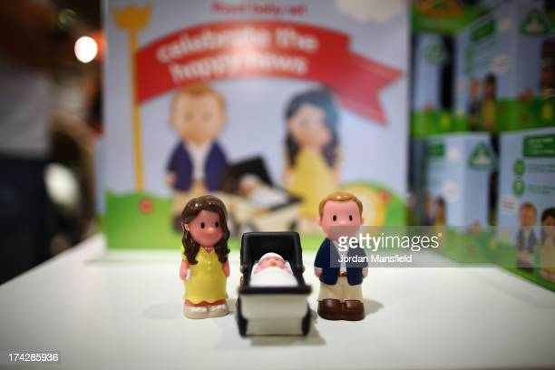 Figurines of the Duke and Duchess of Cambridge go on display in the Oxford Street chain of Mothercare on July 23 2013 in London England The Duchess...