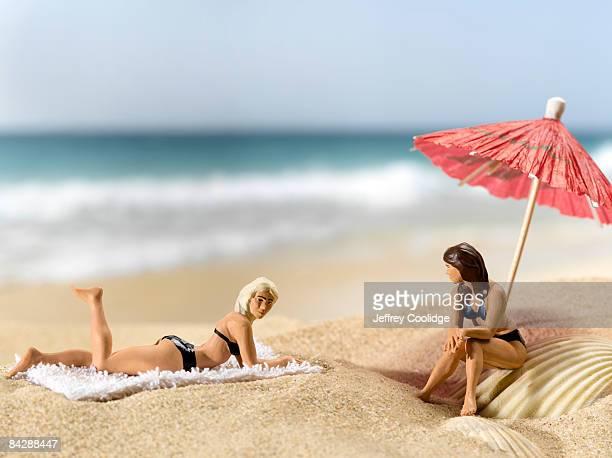 figurines on beach