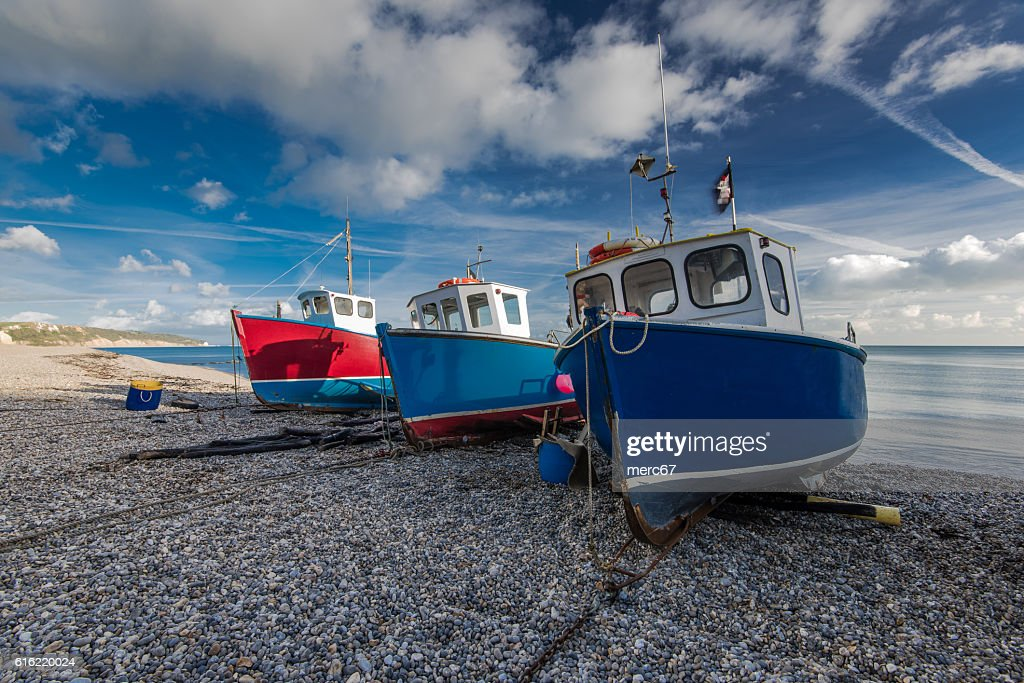 Fiherman boats on pebles at beach in Beer, Devon,UK : Stock Photo