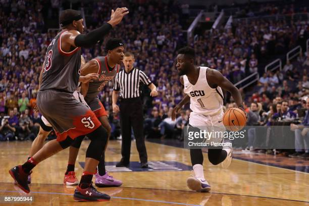 Fiifi Aidoo of the Grand Canyon Antelopes handles the ball during the first half of the college basketball game against the St John's Red Storm at...