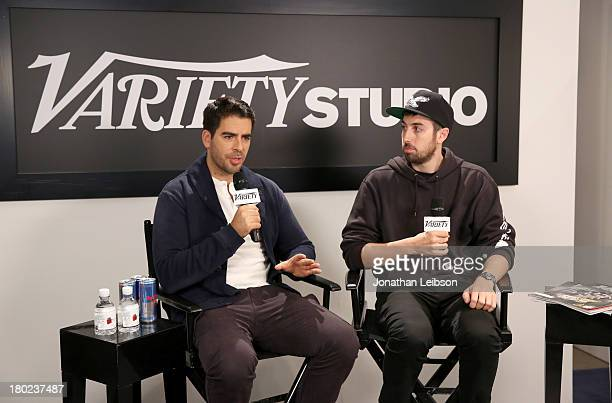 Fiilmmaker Eli Roth and director Ti West attend the Variety Studio presented by Moroccanoil at Holt Renfrew during the 2013 Toronto International...