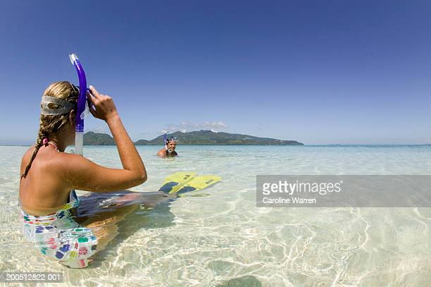 Fiji, Beqa Island, young man and woman snorkeling (focus on woman)
