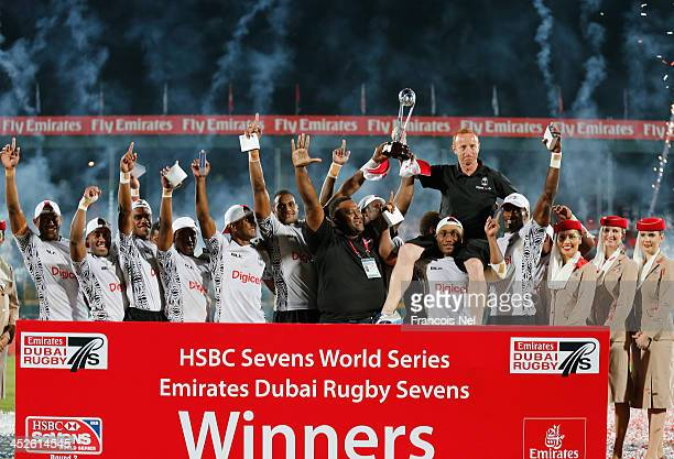 Fiji celebrate after winning the second round of the HSBC Sevens World Series at the Emirates Dubai Rugby Sevens on November 30 2013 in Dubai United...