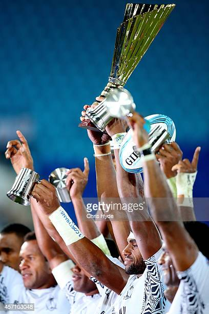 Fiji celebrate winning the 2014 Gold Coast Sevens Cup final match between Fiji and Samoa at at Cbus Super Stadium on October 12, 2014 in Gold Coast,...