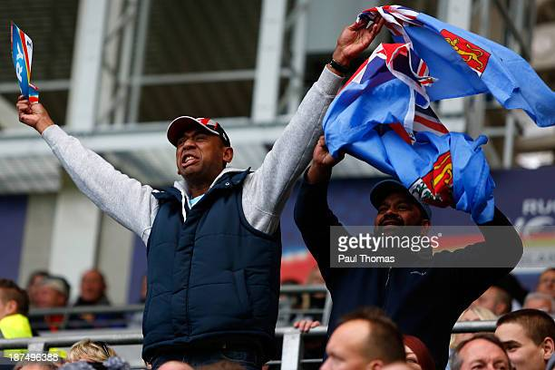 Fiji fans cheer as their side score a try during the Rugby League World Cup Group A match at the KC Stadium on November 9 2013 in Hull England