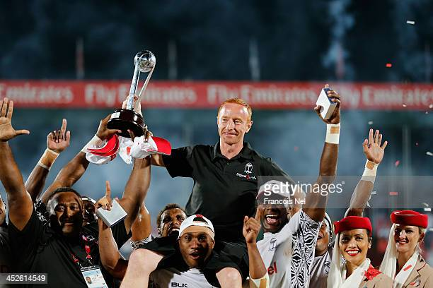 Fiji Head coach Ben Ryan celebrate after winning the second round of the HSBC Sevens World Series at the Emirates Dubai Rugby Sevens on November 30...