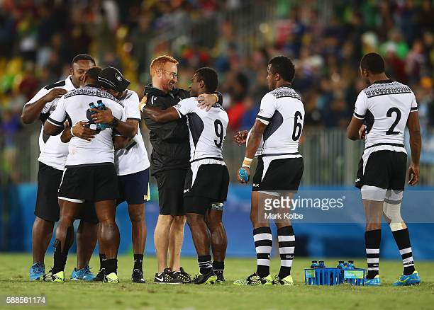 Fiji head coach Ben Ryan celebrates with players as they win gold after the Men's Rugby Sevens Gold medal final match between Fiji and Great Britain...