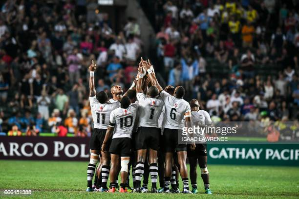 Fiji huddle before playing the Cup Final against South Africa on the third day of the Hong Kong Rugby Sevens Tournament on April 9 2017 / AFP PHOTO /...