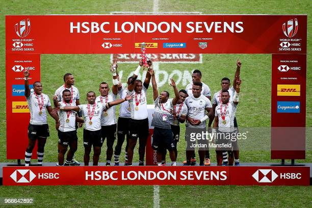 Fiji lift the trophy after victory in the Cup Final match between Fiji and South Africa on day two of the HSBC London Sevens at Twickenham Stadium on...