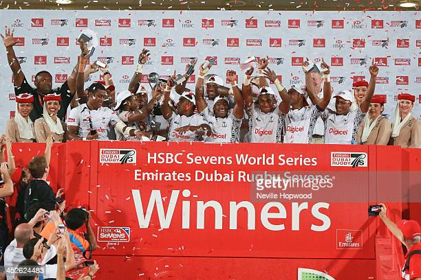 Fiji lift the Trophy aloft for winning the Dubai Rugby Sevens, the second round of the HSBC Sevens World Series at on November 30, 2013 in Dubai,...