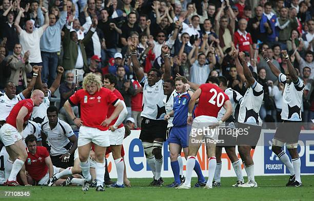 Fiji players celebrate their team's 38-34 victory as the final whistle blows during the Rugby World Cup 2007 Pool B match between Wales and Fiji at...