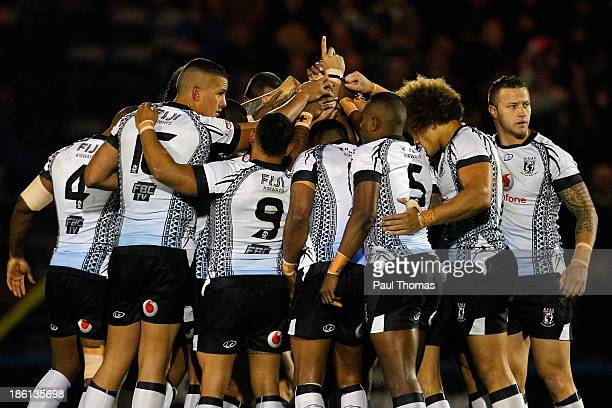 Fiji players huddle before the Rugby League World Cup Group A match between Fiji and Ireland at Spotland Stadium on October 28 2013 in Rochdale...