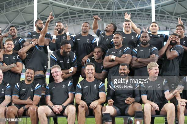 Fiji players pose for a group photo in Oita southwestern Japan on Oct 8 a day before a Rugby World Cup Pool D match against Wales