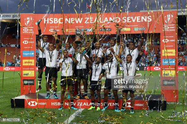 Fiji pose on the podium to celebrate after winning the final gold medal match at the World Rugby Sevens Series between Fiji and South Africa at...