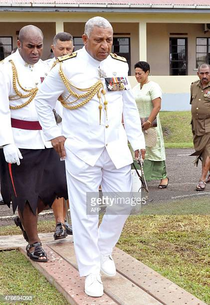 Fiji strongman Voreqe Bainimarama arrives for a ceremony as he resigns as military chief of the coupplagued South Pacific nation in Suva on March 5...