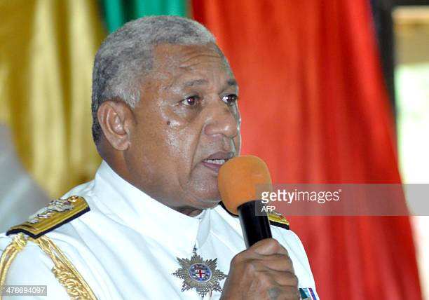 Fiji strongman Voreqe Bainimarama speaks during a ceremony as he resigns as military chief of the coupplagued South Pacific nation in Suva on March 5...