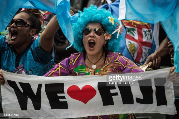 A Fiji supporter cheers during their match against New Zealand at the Hong Kong Rugby Sevens tournament on April 8 2017 / AFP PHOTO / Dale DE LA REY
